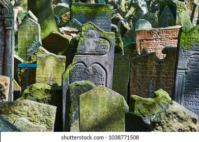 Prague, Czech Republic - April 27, 2009: Tombstones on Old Jewish Cemetery in the Jewish Quarter in Prague.There are about 12000 tombstones presently visible. One of the most important Jewish monument