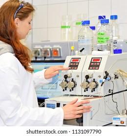 PRAGUE, CZECH REPUBLIC - April 30, 2017: A young researcher conducts research using modular HPLC. Institute of Organic and Biochemistry.