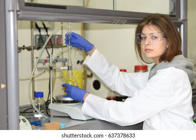PRAGUE, CZECH REPUBLIC - April 30, 2017: A young researcher conducts research using the fume hood of the laboratory. Institute of Organic and Biochemistry