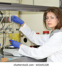 PRAGUE, CZECH REPUBLIC - April 30, 2017: A young researcher conducts research using the fume hood of the laboratory. Institute of Organic and Biochemistry.