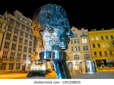 Prague, Czech Republic, April 4, 2019. Metalmorphosis Rotating 42-Layer Sculpture of Franz Kafka's Head by David Cerny at the evening with electrical light