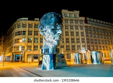 Prague, Czech Republic, April 4, 2019. Metamorphosis Rotating 42-Layer Sculpture of Franz Kafka's Head by David Cerny at the evening with electrical light