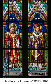 PRAGUE, CZECH REPUBLIC - APRIL 5, 2016: Stained Glass in the Basilica of Vysehrad in Prague, Czech Republic, depicting Saint Clement of Rome and Pope Saint Leo I