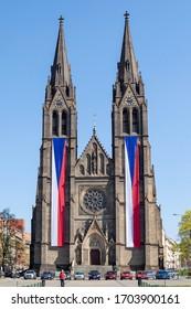 PRAGUE, CZECH REPUBLIC - APRIL 9, 2020: Church of St. Ludmila at the Namesti Miru square, with Czech flags