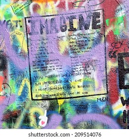 PRAGUE, CZECH REPUBLIC - AUGUST 05: The Lennon Wall since the 1980s is filled with John Lennon-inspired graffiti and pieces of lyrics from Beatles songs on august 05, 2014 in Prague, Czech Republic
