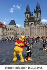Prague, Czech Republic - August 14, 2017: Winnie the Pooh and tourists in the Old Town Square, Prague, Czech.