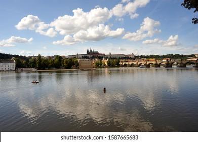 PRAGUE/ CZECH REPUBLIC  - AUGUST 16 2011:  The view of Vltava River, Charles Bridge and Prague Castle from Restaurant Lavka at Karlovy Lazne.