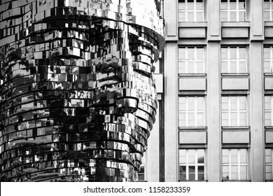 PRAGUE, CZECH REPUBLIC - AUGUST 17, 2018: Statue of Franz Kafka. Glossy metal mechanical sculpture of famous Czech writer. Bust by artist David Cerny. Prague, Czech Republic. Black and white image.