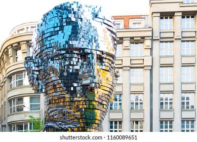 PRAGUE, CZECH REPUBLIC - AUGUST 17, 2018: Statue of Franz Kafka. Glossy metal mechanical sculpture of famous Czech writer. Bust by artist David Cerny. Prague, Czech Republic.