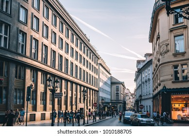 Prague,  Czech Republic - August 18, 2017: Commercial street in historic centre of Prague with large group of people at sunset.