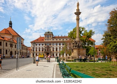 PRAGUE, CZECH REPUBLIC - AUGUST 18, 2018: Tourists in walking on old town in Hradcany Square.