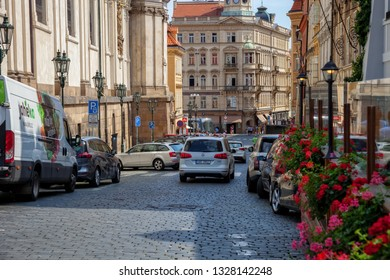 PRAGUE, CZECH REPUBLIC - AUGUST 18, 2018: Tourists in walking on the Old Prague streets in Czech Republic.