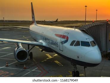 PRAGUE, CZECH REPUBLIC - AUGUST 2018: British Airways Airbus A320 aircraft at Prague airport as dawn starts to break.