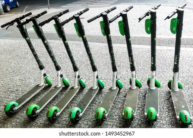 Prague, Czech republic - august 2019: group of the Lime bikes/scooters parked on the street of the Karlin district
