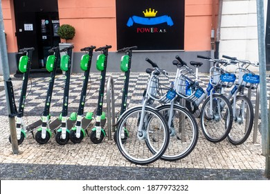 Prague, Czech republic - august 2020: group of the Lime scooters and NextBike bicycles parked on the street of the Karlin district