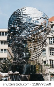Prague, Czech Republic - August 23, 2018: Rotating Head of Franz Kafka, an outdoor sculpture by David Cerny in Prague. The kinetic sculpture is 11 metres tall and made of 42 rotating panels.