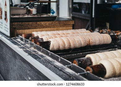 Prague, Czech Republic - August 23, 2018: Trdelnik, a sweet spit cake that is popular amongst locals and tourists,  on sale in Prague, Czech Republic.