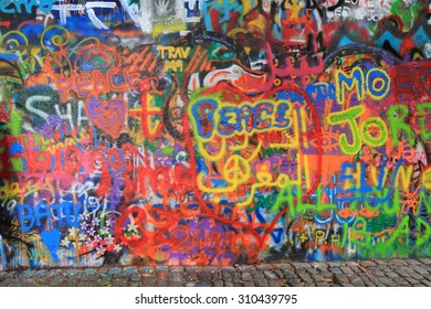 PRAGUE, CZECH REPUBLIC - AUGUST 23, 2015: Various pictures and text messages 'decorate' the John Lennon Wall in Prague, which is very popular among young artists and tourists.
