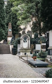 Prague, Czech Republic - August 26, 2018: Vysehrad cemetery near the Basilica of St. Peter and St. Paul. Vysehrad cemetery is the final resting place of many famous composers, artists and politicians.