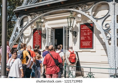 Prague, Czech Republic - August 26, 2018: People queuing for Petrin Tower, Prague, a popular tourist destination on top of the Petrin Hill that offers beautiful views of the city.