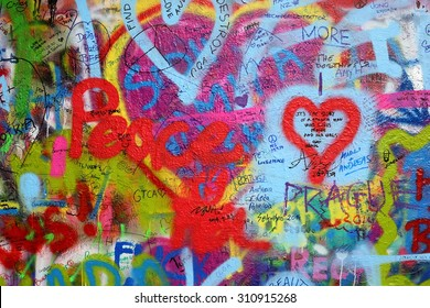 PRAGUE, CZECH REPUBLIC - August 28: The Lennon Wall since the 1980s is filled with John Lennon-inspired graffiti and pieces of lyrics from Beatles songs on August 28, 2015 in Prague, Czech Republic