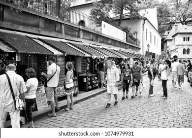 PRAGUE, CZECH REPUBLIC - AUGUST 3, 2008: People visit Jewish Quarter in Prague, Czech Republic. Old Prague is a UNESCO World Heritage Site. Half of Czech tourism income is spent in Prague.