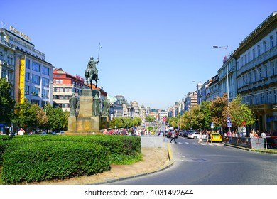 PRAGUE, CZECH REPUBLIC - AUGUST 30;  people on Wenceslas Square public center and around base of statue in European city with statue of historic King Wenceslas  August 30 2017 Prague Czech Republic