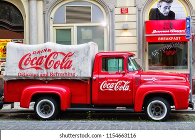 PRAGUE, CZECH REPUBLIC - AUGUST 5 2018: An old renovated red Ford F-100 vintage Coca cola truck (pickup) in a parking lot., Czech Republic