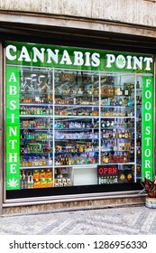 PRAGUE, CZECH REPUBLIC - AUGUST 5, 2018: Font of a souvenir shop with cannabis, absinthe and alcohols. Czech Republic allows private consumption of absinthe, marijuana and other substances