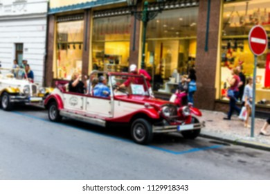 Prague, Czech Republic . Blurred view of vintage cars for sightseeing in city center