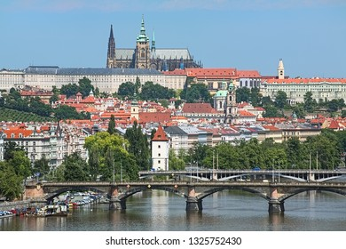 Prague, Czech Republic. Prague Castle with St. Vitus Cathedral, Mala Strana district and bridges across Vltava river. View from Vysehrad Hill.