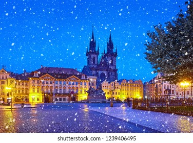 Prague, Czech Republic Central Old Town square in old town. Night view at Church of Our Lady Before Tyn with nighttime illumination. Christmas holiday. Winter snowfall and blue sky.