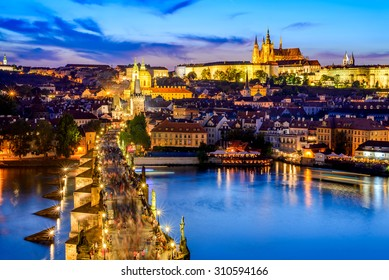 Prague, Czech Republic. Charles Bridge and Hradcany (Prague Castle) with St. Vitus Cathedral and St. George church evening dusk, Bohemia landmark in Praha.