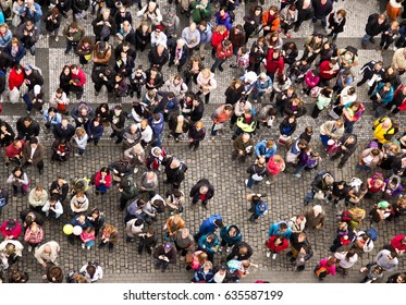 PRAGUE, CZECH REPUBLIC - CIRCA JUNE 2013: The crowd of people on the square in the center of Prague. People make photos of sight, view from above