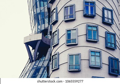 """PRAGUE, CZECH REPUBLIC - CIRCA SEPTEMBER 2009: The Dancing House (nicknamed """"Fred and Ginger""""), designed by architects Vlado Miluni? and Frank Gehry in Prague."""
