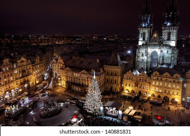 PRAGUE, CZECH REPUBLIC - DEC 12: Old Town Square with illuminated buildings and Church of Our Lady of Tyn, with gothic facade and 80 meter tall towers. December 12, 2012 Prague, Czech Republic