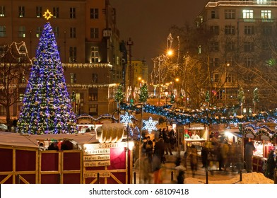 PRAGUE, CZECH REPUBLIC - DEC 17: Group of people enjoy Christmas market in Prague on December 17, 2010 in Prague. It attracts more than 750 thousands of visitors during the whole advent time.
