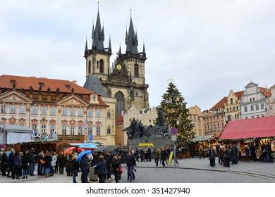 PRAGUE, CZECH REPUBLIC - DECEMBER 02: Unidentified people on yearly Christmas market on old town square with Jan Hus memorial and Tyn church, on December 02, 2015 In Prague, Czech Republic
