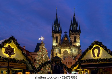 PRAGUE, CZECH REPUBLIC - DECEMBER 10, 2016: Illuminated stalls, decorated Xmas Tree and Tyn Church during famous traditional Christmas market taking place each year in december in Old Town of Prague.