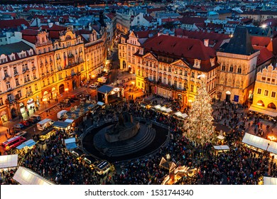 PRAGUE, CZECH REPUBLIC - DECEMBER 11, 2016: View from above on evening Staromestske Namesti and Christmas market - famous and popular event taking place in Old Town of Prague, Czech Republic.