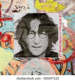 PRAGUE, CZECH REPUBLIC - DECEMBER 11: The Lennon Wall since the 1980s is filled with John Lennon-inspired graffiti and pieces of lyrics from Beatles songs on Dec 11, 2015 in Prague, Czech Republic