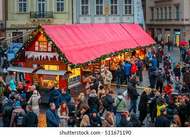 PRAGUE, CZECH REPUBLIC - DECEMBER 11, 2015: Wooden stalls offering souvenirs and traditional food during Christmas market taking place each year on December in Old Town Square.