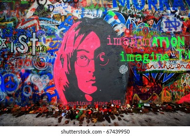 PRAGUE, CZECH REPUBLIC - DECEMBER 11: The Lennon Wall since the 1980s is filled with John Lennon-inspired graffiti and pieces of lyrics from Beatles songs on Dec 11, 2010 in Prague, Czech Republic