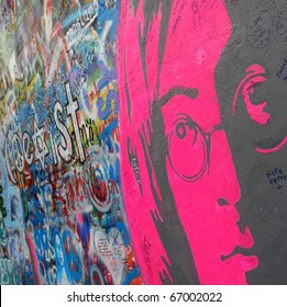 PRAGUE, CZECH REPUBLIC - DECEMBER 11:The Lennon Wall since the 1980s filled with John Lennon-inspired graffiti and pieces of lyrics from Beatles songs on Dec 11, 2010 in Prague, Czech Republic