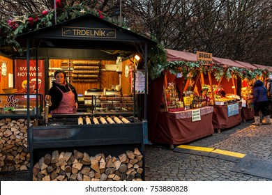 PRAGUE, CZECH REPUBLIC - DECEMBER 12, 2016: Kiosks with souvenirs, hot drinks and traditional trdelnik spit cakes on the strret of Old Town of Prague during famous annual Christmas Market.