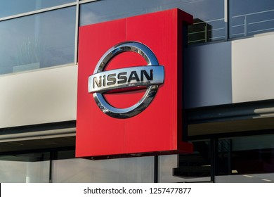 PRAGUE, CZECH REPUBLIC - DECEMBER 13 2018: Nissan motor company logo in front of dealership building on December 13, 2018 in Prague, Czech Republic.