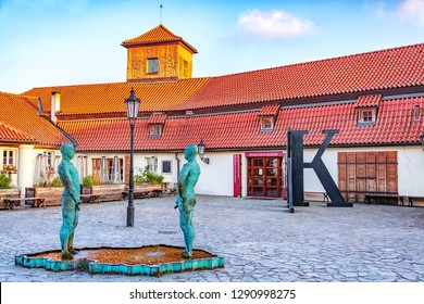 Prague, Czech Republic - December 13, 2018: Sculpture by David Cerny - Fountain of Pissing Men in front of Franz Kafka museum in Prague.