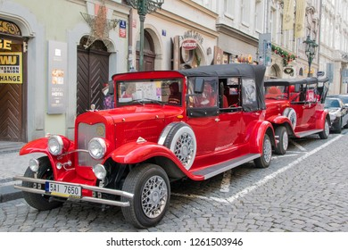 PRAGUE, CZECH REPUBLIC - DECEMBER 14, 2018: Old vintage Ford car used as sightseeing tour car for tourists in the city center of Prague, Czech Rebpulic