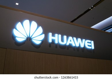 PRAGUE, CZECH REPUBLIC - DECEMBER 14 2018: Huawei telecommunications equipment and electronics company logo on mobile phone shop on December 14, 2018 in Prague, Czech Republic.