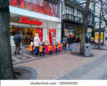 Prague, Czech Republic December 18, 2018 - Children in orange vests walking in the center of Prague, accompanied by caregivers